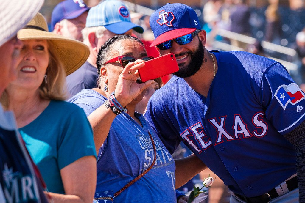 Texas Rangers outfielder Nomar Mazara poses for a photo with a fan before a spring training baseball game against the Seattle Mariners on Tuesday, Feb. 26, 2019, in Peoria, Ariz.. (Smiley N. Pool/The Dallas Morning News)