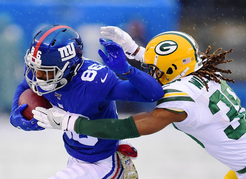 EAST RUTHERFORD, NEW JERSEY - DECEMBER 01: Darius Slayton #86 of the New York Giants runs the ball as Tramon Williams #38 of the Green Bay Packers tackles him in the first half of their game at MetLife Stadium on December 01, 2019 in East Rutherford, New Jersey. (Photo by Emilee Chinn/Getty Images)