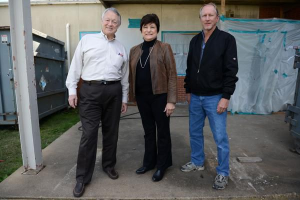 Cedar Hill High School alumni (from left) Joe Pitt, Sandra Barber and Johnny Krueger stand outside what used to be the front entrance to their high school before it was vacated and turned into the district's administration building in 1978. The building, opened in 1957, will be demolished to make way for a projected $2.47 million, 318,000-square-foot baseball/softball facility.