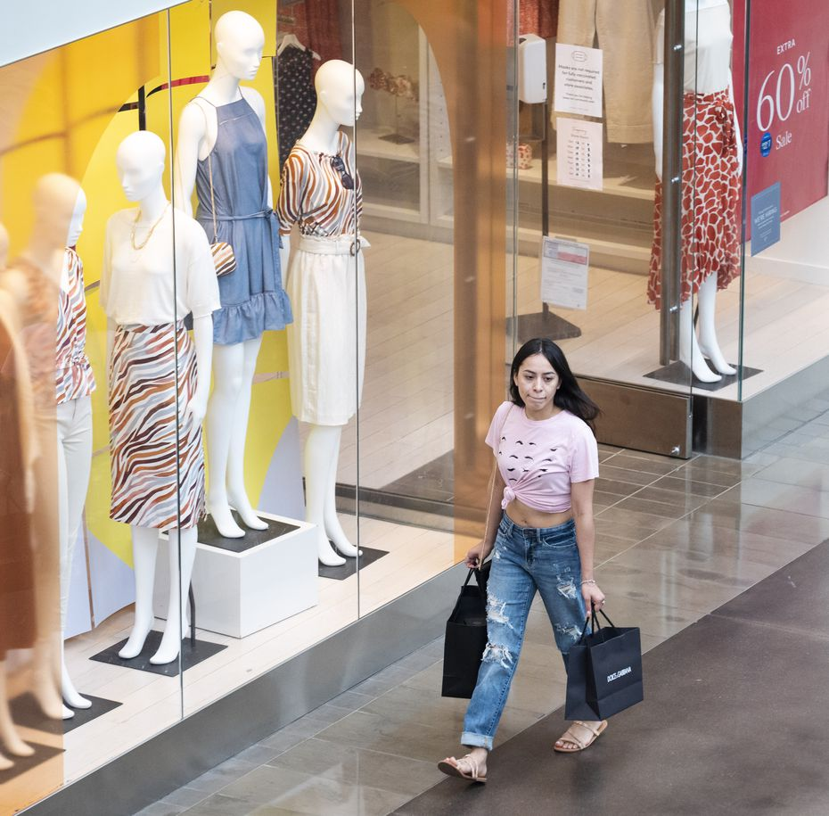 A young woman shops at NorthPark Center in Dallas.