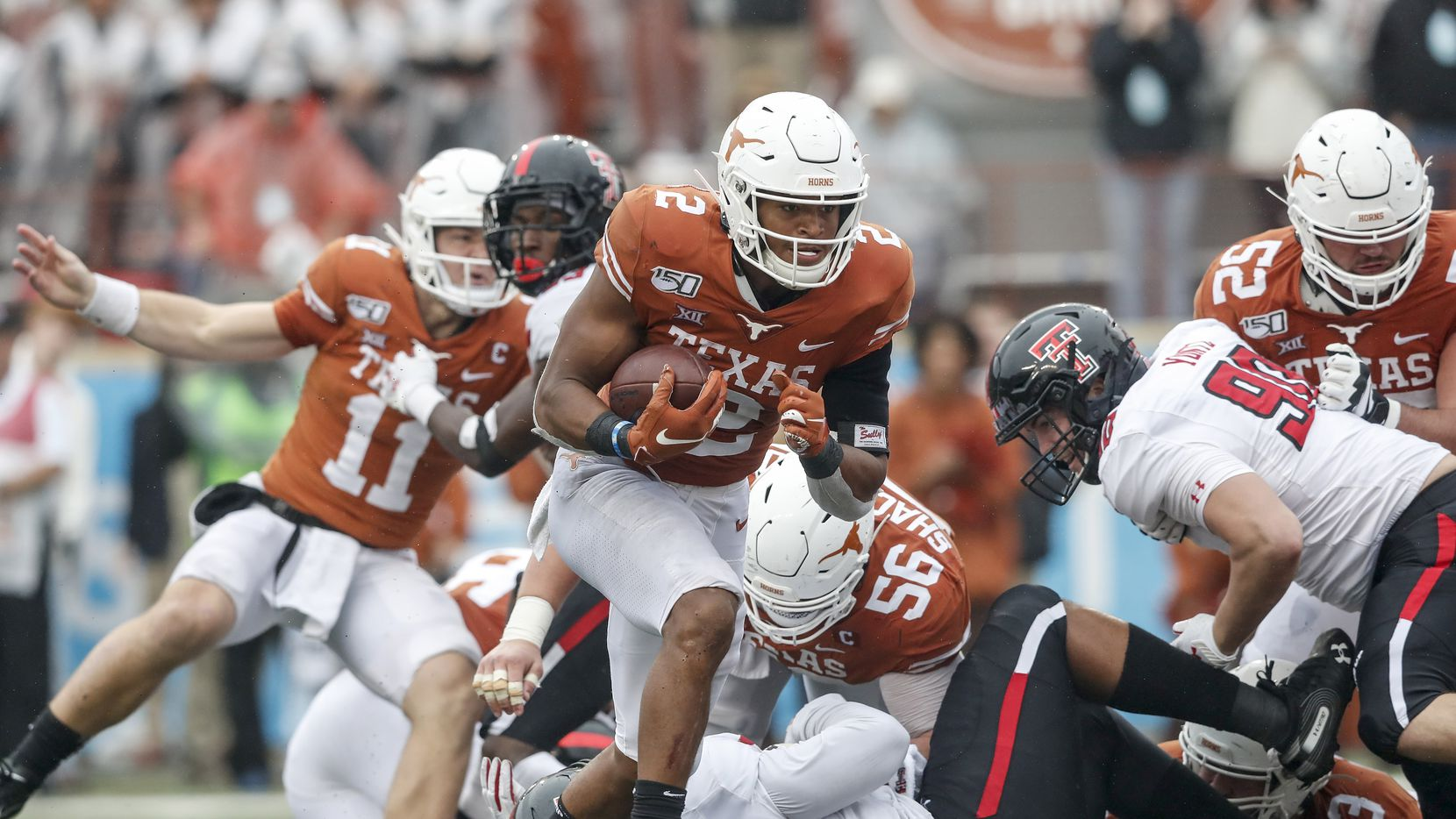 AUSTIN, TX - NOVEMBER 29:  Roschon Johnson #2 of the Texas Longhorns rushes for a touchdown in the fourth quarter against the Texas Tech Red Raiders at Darrell K Royal-Texas Memorial Stadium on November 29, 2019 in Austin, Texas.