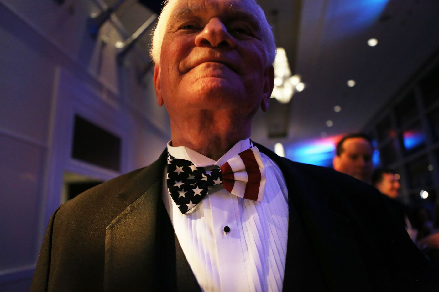 A reveler poses at the Texas Black Tie and Boots inaugural ball on January 19, 2017 in National Harbor, Maryland. President-elect Donald Trump will be sworn in as the 45th president of the United States tomorrow.