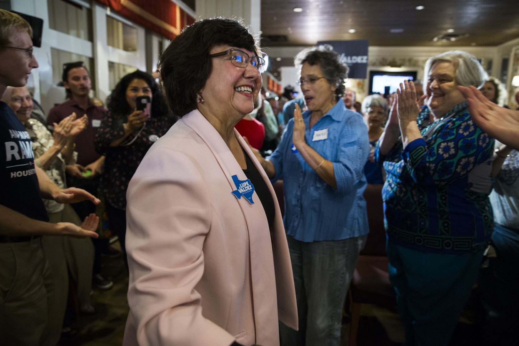 Gubernatorial candidate and former Dallas County Sheriff Lupe Valdez makes her way to a podium after her runoff win at a democratic party celebration at Ellen's in Dallas on Tuesday, May 22, 2018.