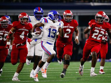 Duncanville's Roderick Daniels	(13) tries to outrun North Shore's defense during the third quarter of a Class 6A Division I state championship game at the AT&T Stadium in Arlington, on Saturday, December 21, 2019. North Shore won 31-17. (Juan Figueroa/The Dallas Morning News)