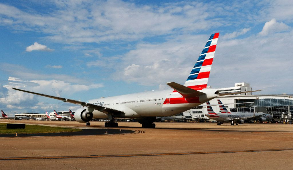 An American Airlines plane taxis at DFW International Airport.
