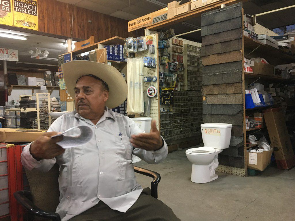 Santos Coria, a Mexican entrepreneur who does business with the city of Dallas, sits in his West Dallas store, Discount Construction Material, in October 2016. (Naomi Martin/ Dallas Morning News)