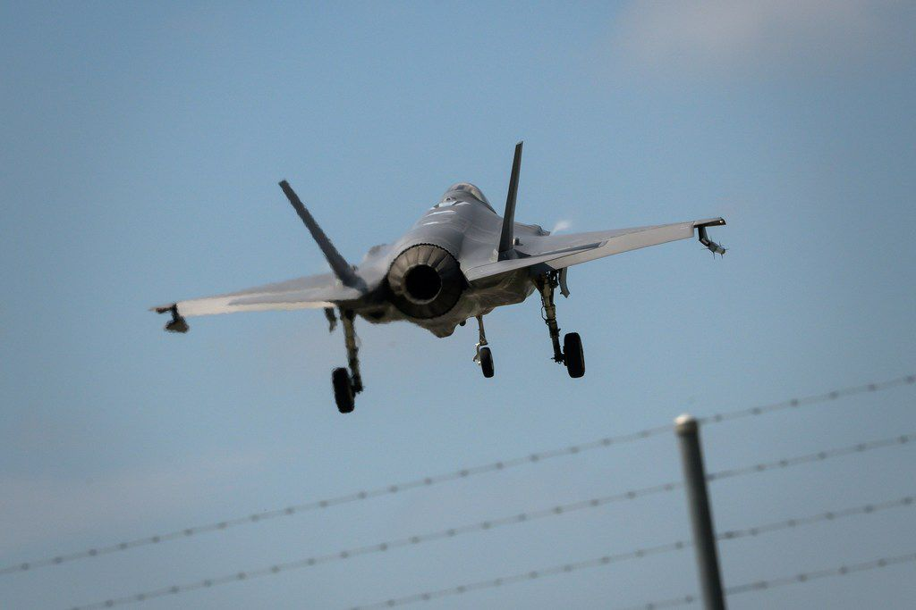 A Lockheed Martin F-35 Lightning II fighter jet is landing at the Payerne Air Base during flight and ground tests.