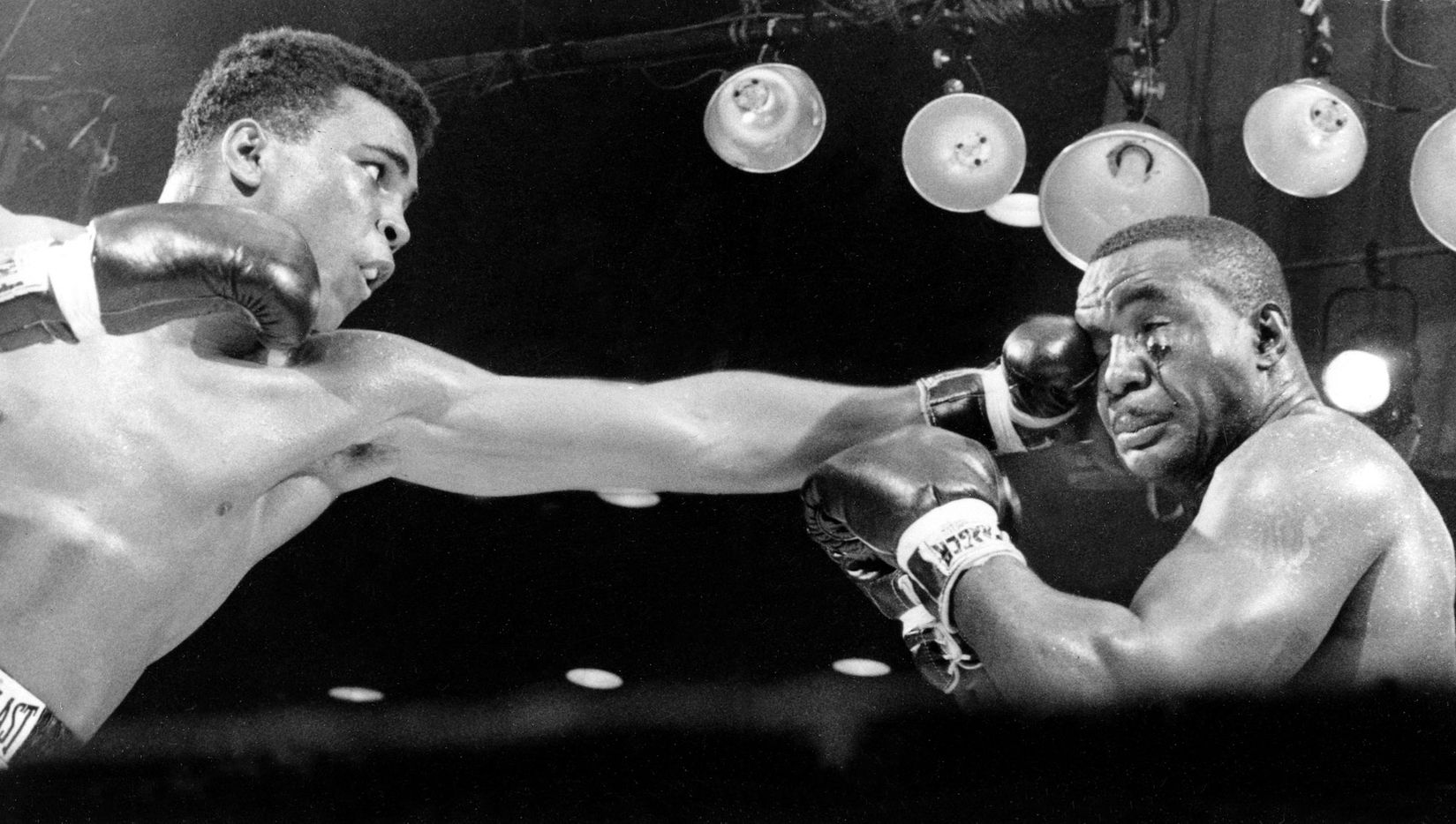 Cassius Clay, left, connects on a punch to the face of Sonny Liston in the third round before a TKO in the seventh round of their heavyweight championship fight in Miami Beach, Fla., on Feb. 25, 1964.