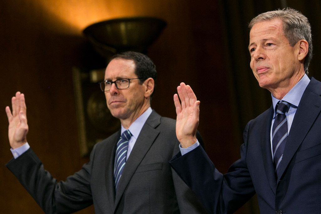 Randall Stephenson, Chairman & CEO of AT&T, left, and Jeffrey Bewkes, Chairman & CEO of Time Warner, right, are sworn in before the United States Senate Committee on the Judiciary Subcommittee on Antitrust, Competition Policy & Consumer Rights during a hearing on the pending AT&T and Time Warner merger in Washington, D.C. on Dec. 7, 2016. (Kristoffer Tripplaar/Sipa USA/TNS)