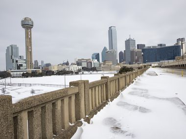 A snow-covered Downtown Dallas seen from S. Houston St. on Monday, Feb. 15, 2021. (Juan Figueroa/ The Dallas Morning News)