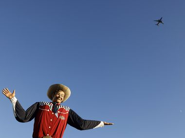 A Southwest Airlines flight passes over Big Tex during the State Fair of Texas at Fair Park in Dallas.