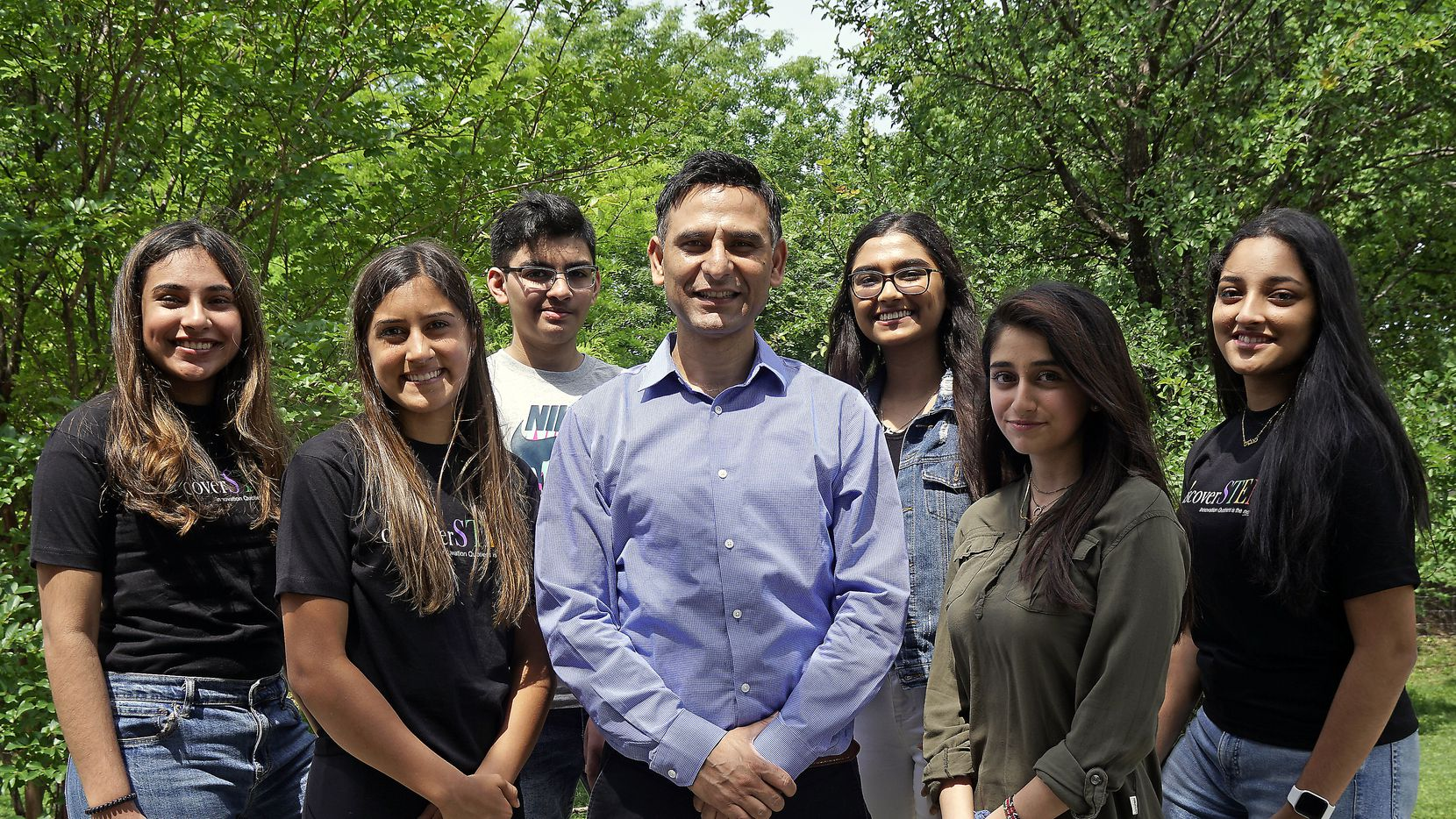 Mirza Faizan (center) mentors several students through the DiscoverSTEM Academy, shown in a photograph taken before social distancing orders. More than 50 of his students have patents pending after winning international competitions. Some of his alumni have gone on to Harvard, Stanford, Duke and MIT, with cumulative scholarships totaling $3.5 million. He is shown with students (from left) Nadia Mustafa, 17; Maya Kusumakar, 14; Hisham Ahmed, 12; Ezzah Azka Rafique, 17; Inaya Sheikh, 17; and Raghavi Danduboyina, 16.