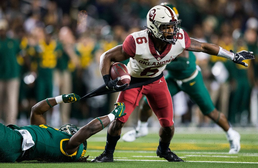 Baylor Bears running back JaMycal Hasty (6) tackles Oklahoma Sooners cornerback Tre Brown (6) during the first quarter of an NCAA football game between Baylor University and Oklahoma University on Saturday, November 16, 2019 at McLane Stadium in Waco, Texas. (Ashley Landis/The Dallas Morning News)