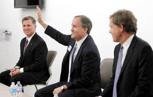 Texas Attorney General Ken Paxton (center) is the subject of many of today's Letters to the Editor.