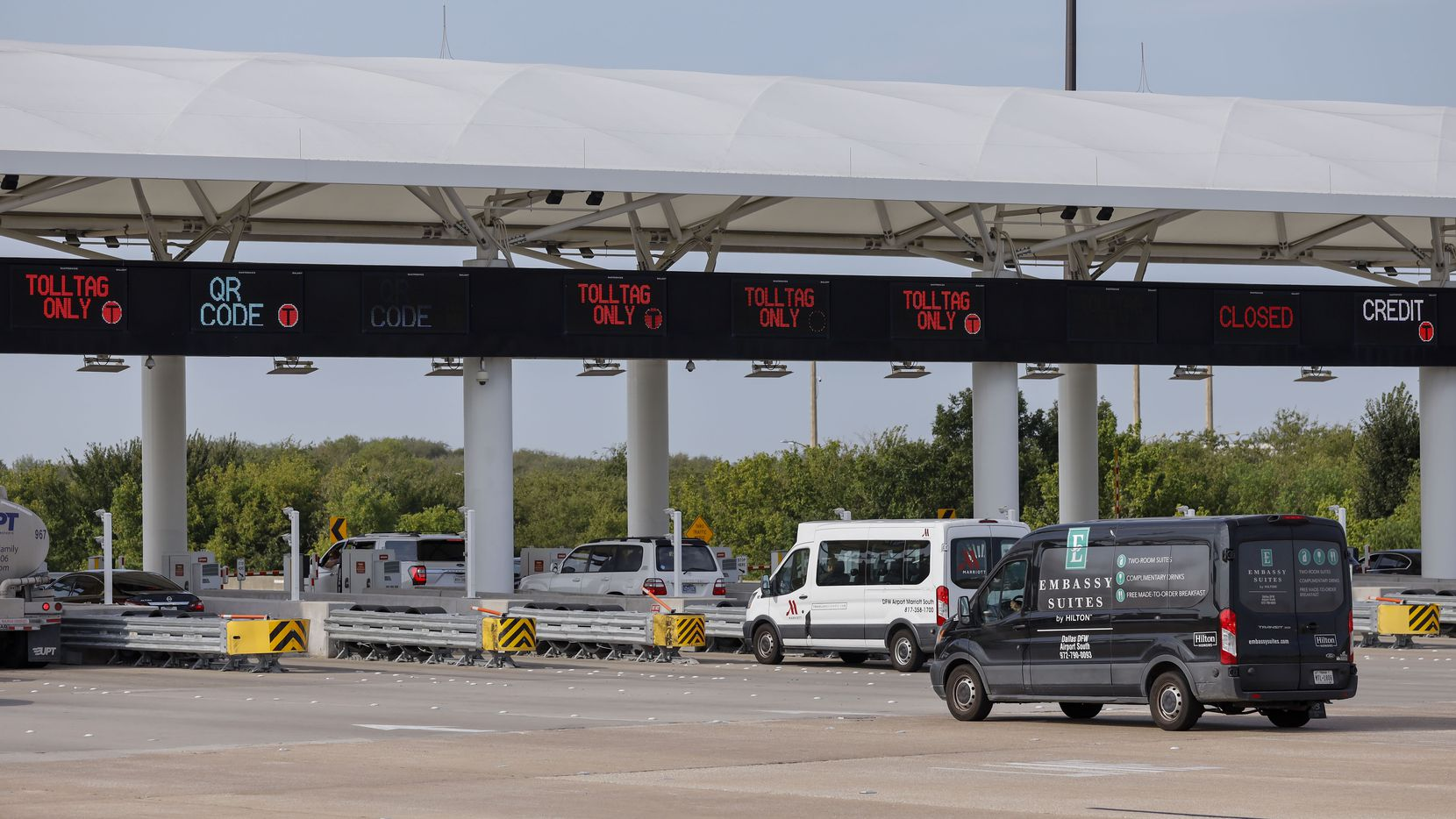 Vehicles stop at toll booths at the Dallas Fort Worth International Airport's south entrance.