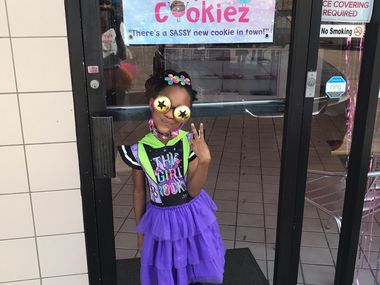 """Kay Clark, 7, bakes, takes orders, serves cookies and does """"everything from A to Z"""" at the bakery she runs with her mom, Latwanna Clark."""