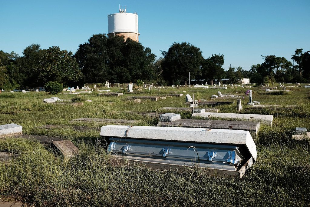 A casket, uprooted by the floods, sat in a cemetery in Orange last week.