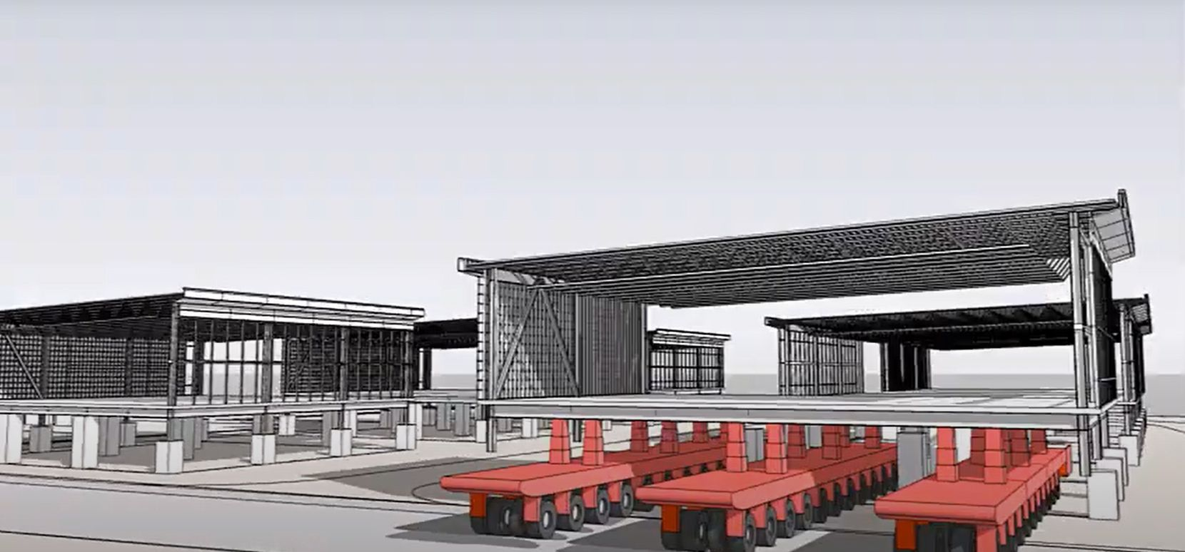 A screenshot from a video showing how sections of the Terminal C expansion at DFW International Airport will be moved from the construction site to the terminal.
