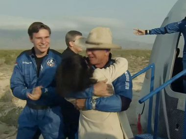 This still image taken from video by Blue Origin shows Jeff Bezos(C), Wally Funk(R) and Oliver Daemen(L) after Blue Origin's reusable New Shepard craft capsule returned from space, safely landing on July 20, 2021, in Van Horn, Texas. - Blue Origin's first crewed mission is an 11-minute flight from west Texas to an altitude of 65 miles (106kms), and back again, to coincide with the 52nd anniversary of the first Moon landing. (Photo by Handout / BLUE ORIGIN / AFP via Getty Images)