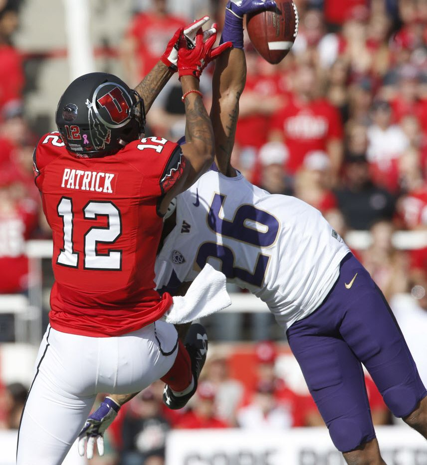 SALT LAKE CITY, UT - OCTOBER 29: Sidney Jones #26 of the Washington Huskies breaks up a pass to Tim Patrick #12 of the Utah Utes during the first half at Rice-Eccles Stadium on October 29, 2016 in Salt Lake City, Utah. (Photo by George Frey/Getty Images)