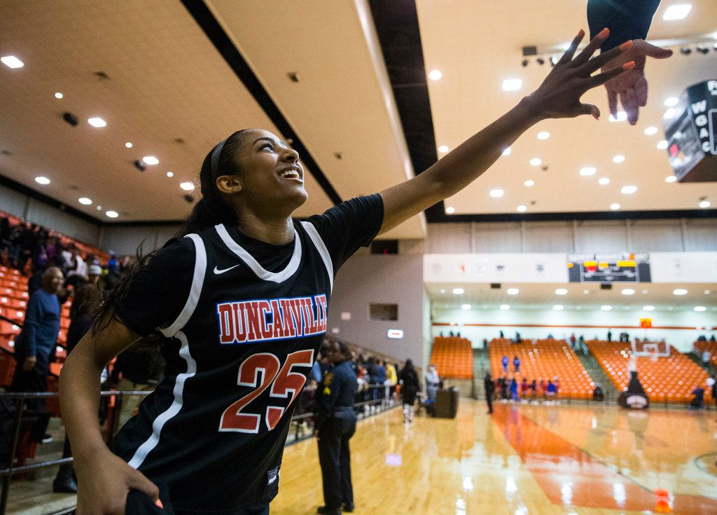 Duncanville's Deja Kelly (25) high-fives a fan as she exits the court after a 47-43 win in a Class 6A Region I quarterfinal girls basketball game between Duncanville and DeSoto on Tuesday, February 25, 2020 at Wilkerson-Greines Activity Center in Fort Worth. (Ashley Landis/The Dallas Morning News)
