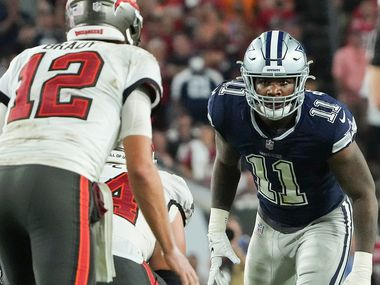 Dallas Cowboys linebacker Micah Parsons (11) eyes Tampa Bay Buccaneers quarterback Tom Brady (12) before a snap during the second half of an NFL football game at Raymond James Stadium on Thursday, Sept. 9, 2021, in Tampa, Fla.