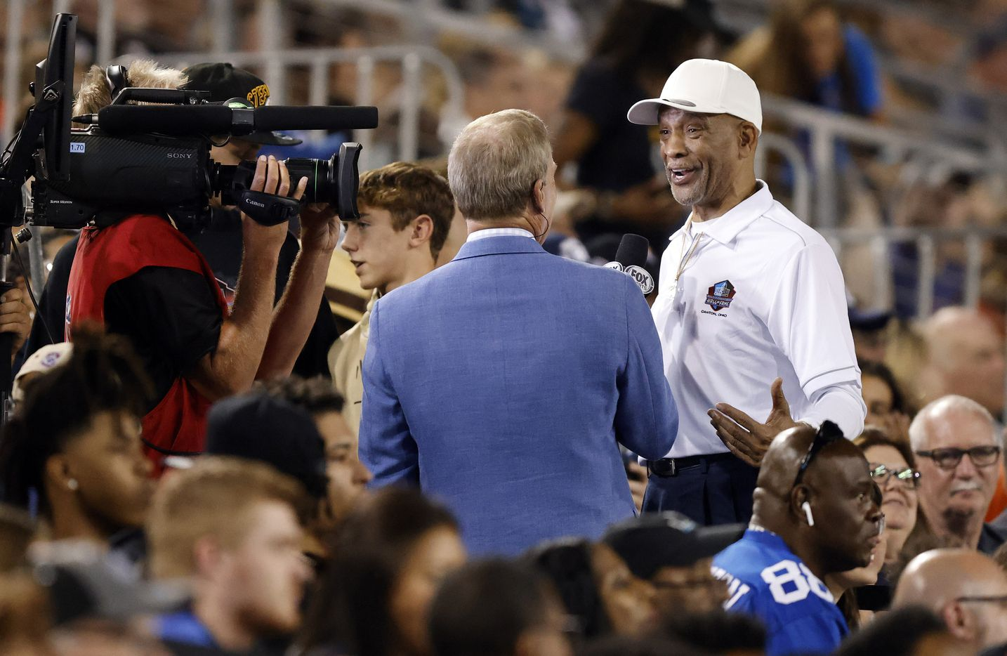 Dallas Cowboys Pro Football Hall of Fame inductee Drew Pearson (right) laughs with a FOX Sports broadcaster during the Cowboys Steelers preseason game at Tom Benson Hall of Fame Stadium in Canton, Ohio, Thursday, August 5, 2021. (Tom Fox/The Dallas Morning News)