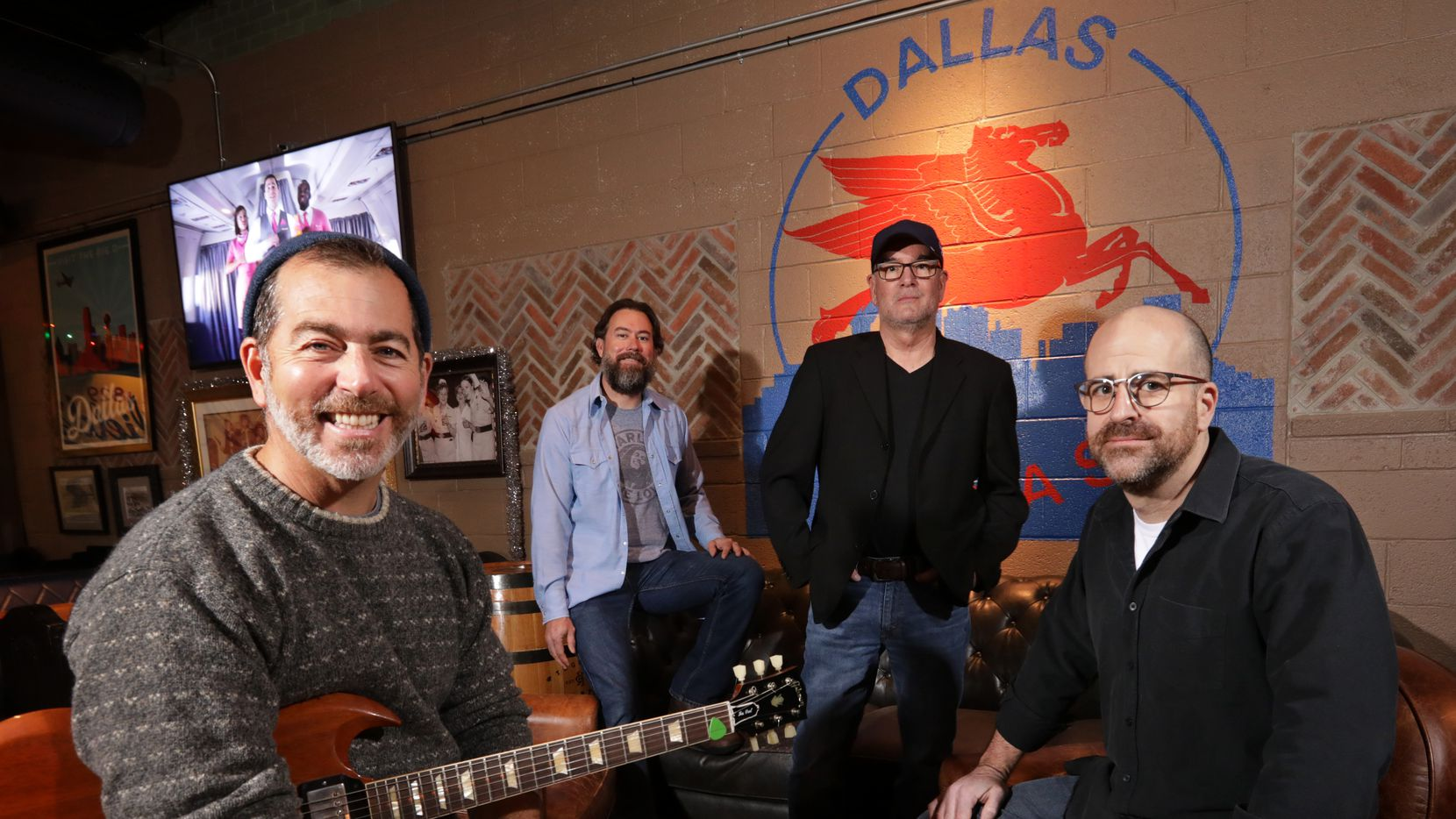 Bandolero band members Rick Sukkar (left) Paul Corliss, Pete Duncan, and Rob Danz pose for a photograph at Redfield's Neighborhood Tavern on Wednesday.