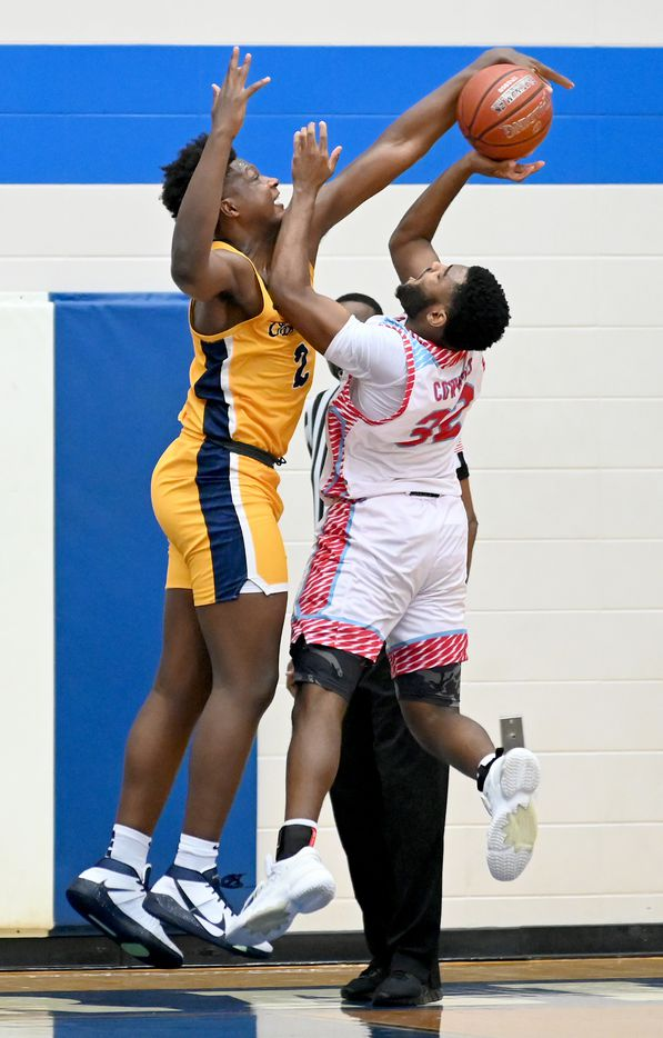 Faith Family's Brandon Walker (2) blocks a shot by Carter's Walter Taylor III in the second half during a Class 4A Region II final boys playoff basketball game between Dallas Carter and Oak Cliff Faith Family, Friday, March 5, 2021, in Grand Prairie, Texas. (Matt Strasen/Special Contributor)