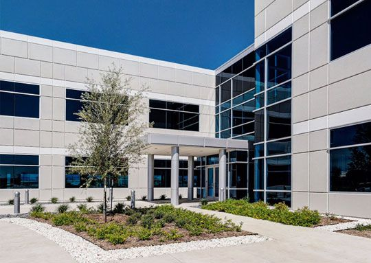 Photo of CompuCom's Plano headquarters. The company is moving its headquarters to South Carolina next year.