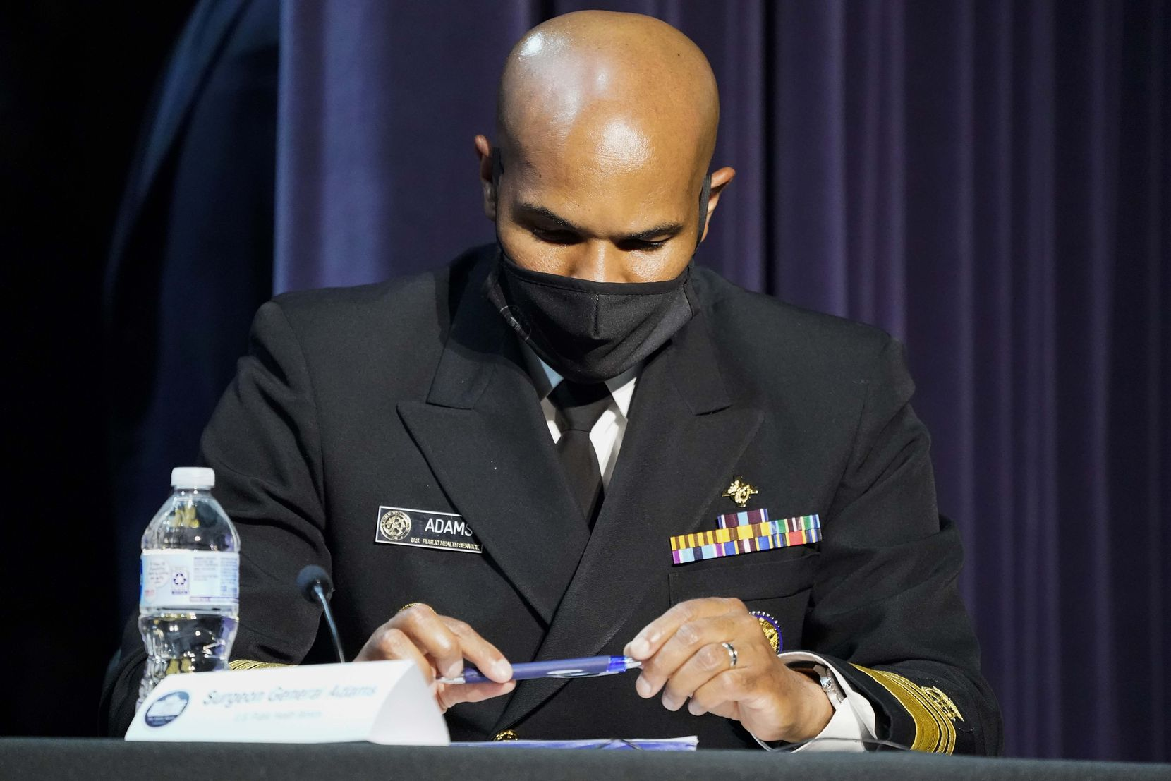 Surgeon General Jerome Adams takes notes during a roundtable conversation about race relations and policing at Gateway Church Dallas Campus on Thursday.
