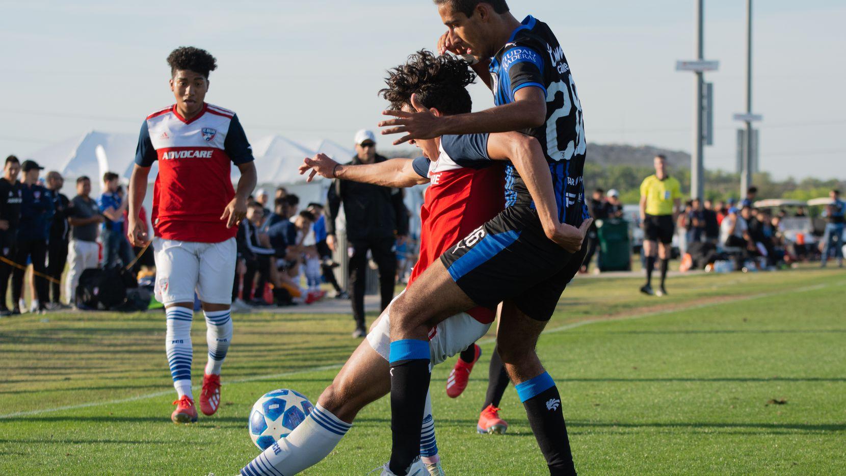 FC Dallas U19 Johan Gomez shields off a Queretaro defender during the 2019 Dallas Cup at MoneyGram Park.