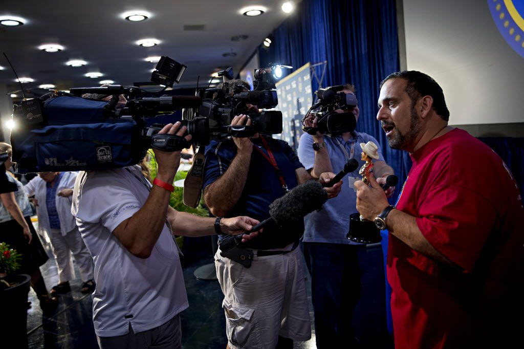 """Isaac Rousso (far right) speaks to media after winning """"Most Creative"""" during the 2016 Big Tex Choice Awards Sunday, August 28, 2016 at Fair Park in Dallas. The annual event, held ahead of the State Fair of Texas, recognizes the best fried foods entered into consideration for sale at the fair. (G.J. McCarthy/The Dallas Morning News)"""