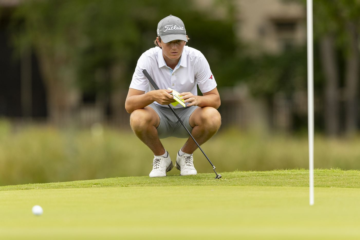 JJ PearceÕs Preston Stout studies hit shot on the 13th green during the final round of the UIL Class 6A boys golf tournament in Georgetown, Tuesday, May 18, 2021. (Stephen Spillman/Special Contributor)