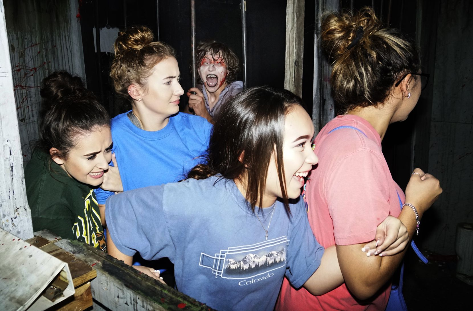 A group of attendees sticks together at Hangman's House of Horrors in Fort Worth in 2017.