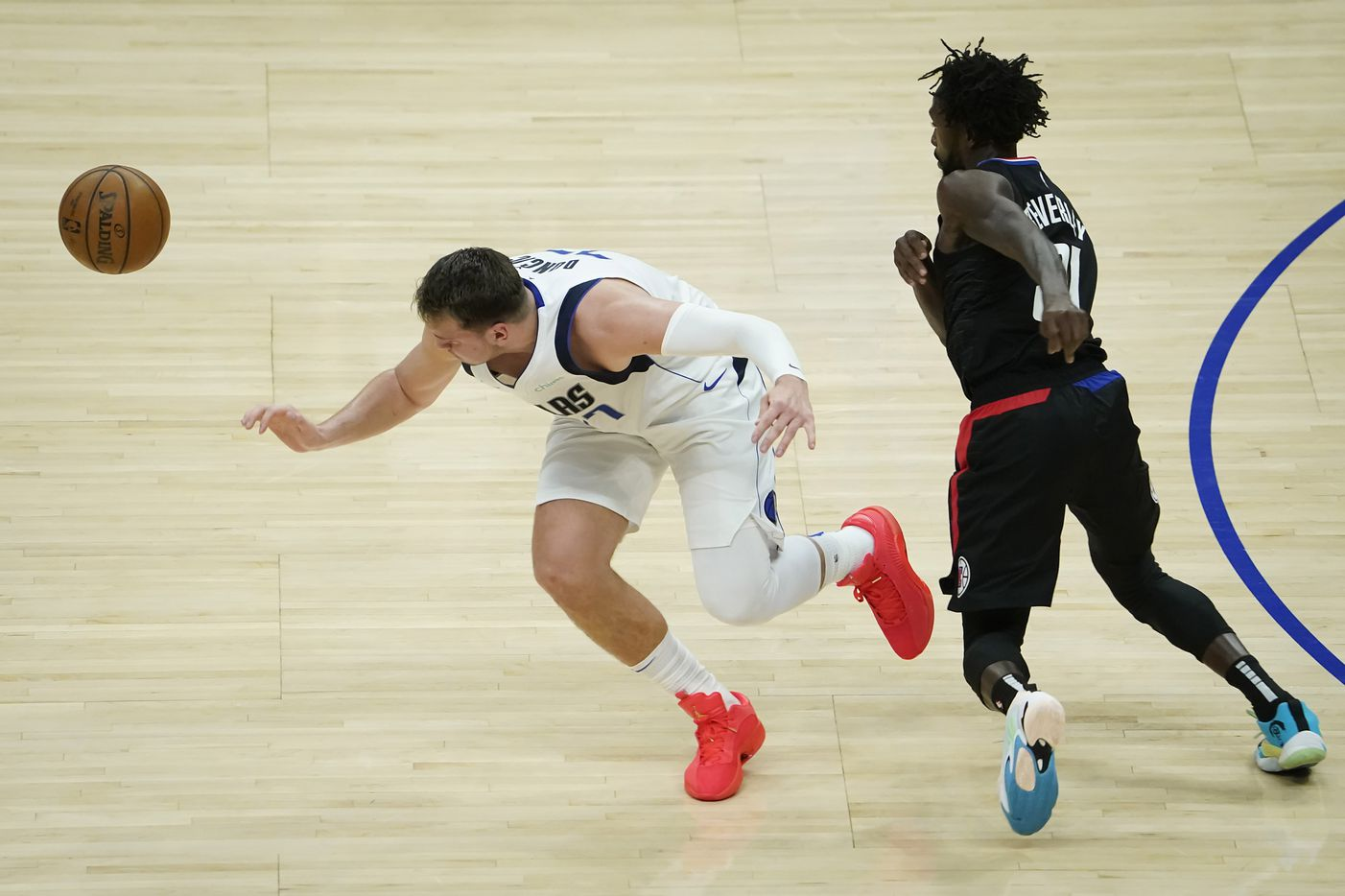 Dallas Mavericks guard Luka Doncic (77) has the ball stolen by LA Clippers guard Patrick Beverley (21) during the first half of an NBA playoff basketball game at Staples Center on Tuesday, May 25, 2021, in Los Angeles.