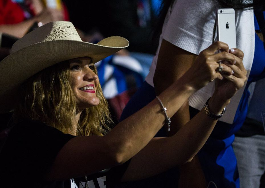 Amber Medina, a delegate from Brownsville, takes a photo with her iPhone during the Democratic National Convention in Philadelphia. (Ashley Landis/Staff Photographer)