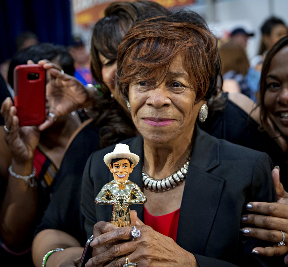 """Ruth Hauntz tears up as she grasps her trophy for """"Best Taste"""" during the 2016 Big Tex Choice Awards Sunday, August 28, 2016 at Fair Park in Dallas. The annual event, held ahead of the State Fair of Texas, recognizes the best fried foods entered into consideration for sale at the fair. (G.J. McCarthy/The Dallas Morning News)"""