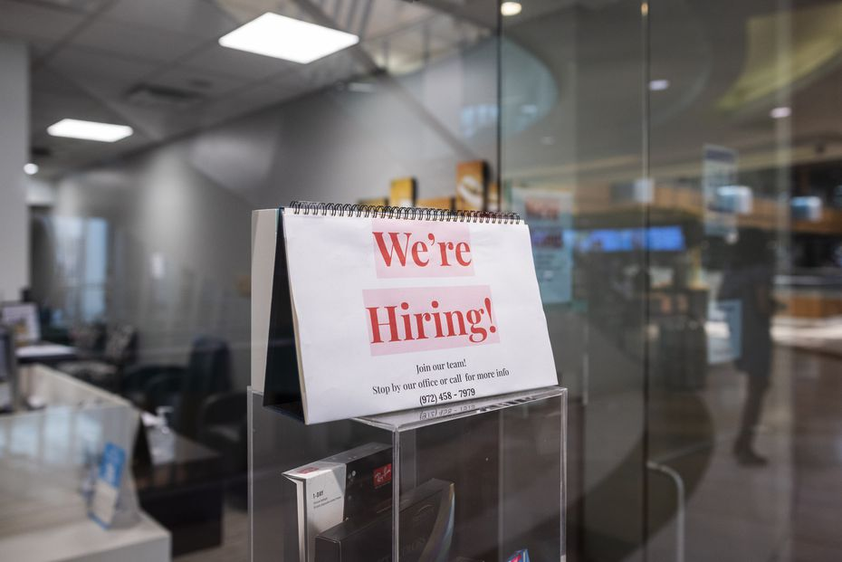 """""""We're hiring"""" sign at LensCrafters in Galleria Dallas."""