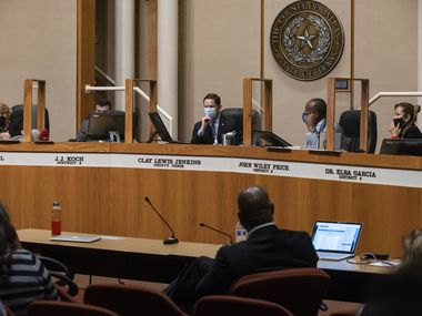 Dallas County Judge Clay Jenkins, center, and county commissioners listen to a presentation during a Dallas County Commissioners Court meeting at the Dallas County Administration Building in Dallas on Tuesday, May 18, 2021. (Lynda M. González/The Dallas Morning News)