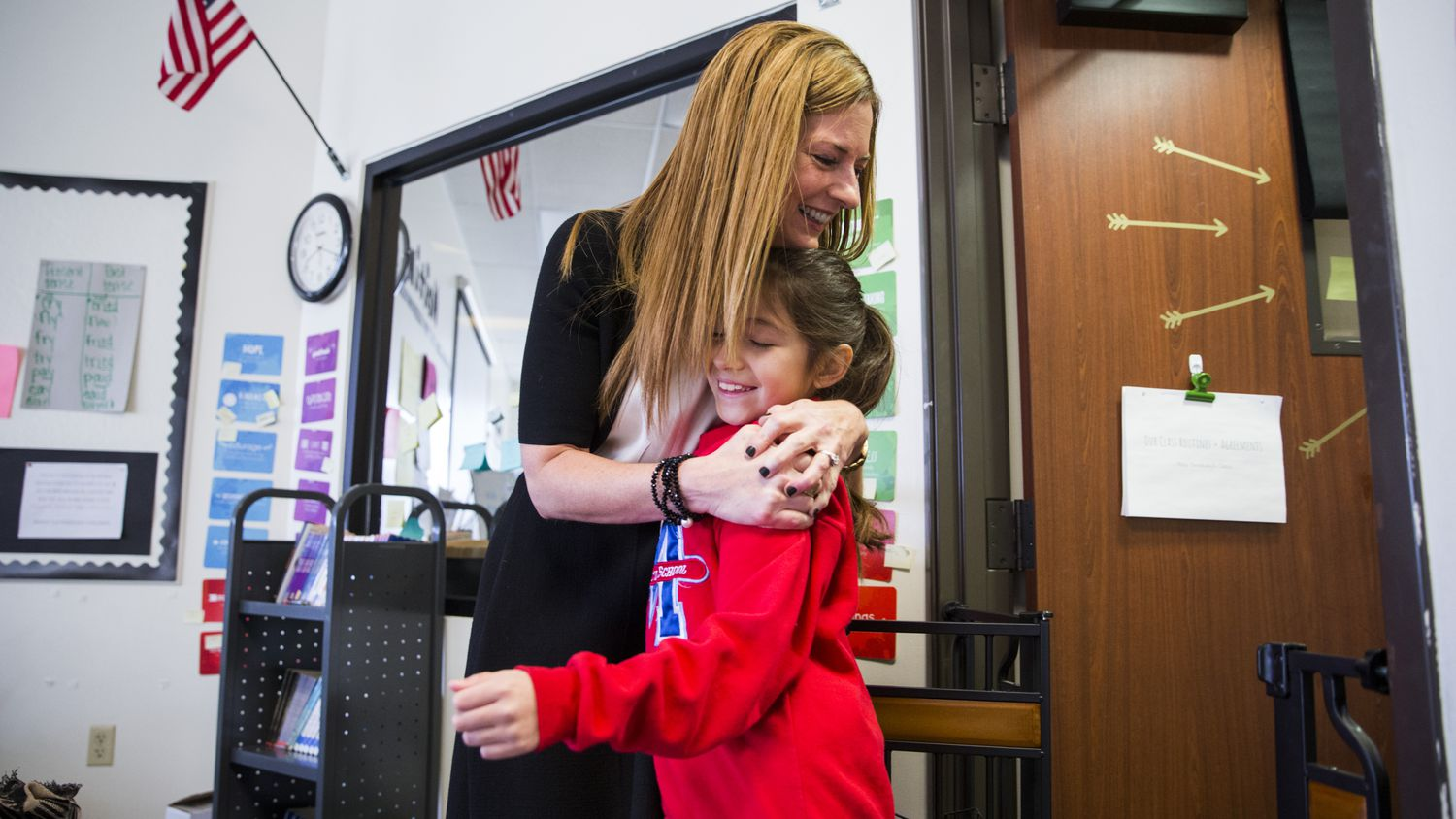 Michelle Kinder, the former executive director of the Momentous Institute, hugs fourth-grader Rebecca before morning circle time in 2019, prior to her departure from the campus.