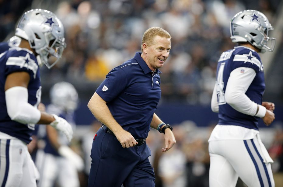 Dallas Cowboys head coach Jason Garrett leads his team down the field during pregame warmups before facing the Los Angeles Rams at AT&T Stadium in Arlington, Texas, Sunday, December 15, 2019.