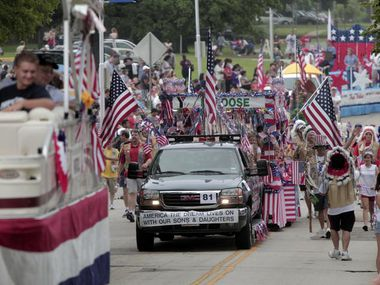 Arlington's annual Independence Day Parade makes its way north on West Street in this file photo.