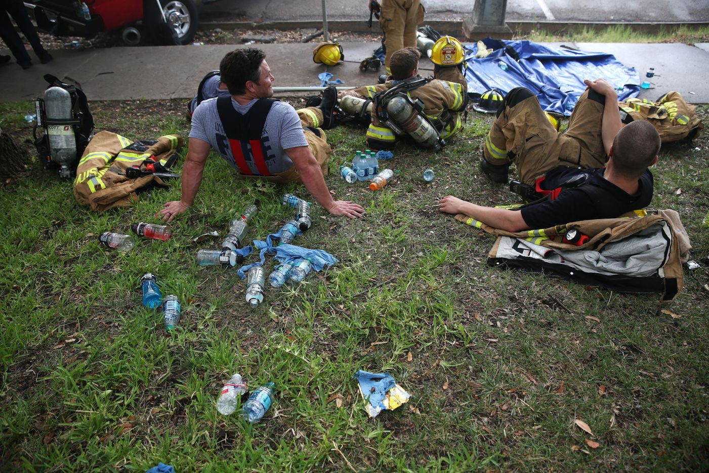 Firefighters rest while battling flames at Goff's Hamburgers in Dallas on Aug. 12, 2016. (Rose Baca/The Dallas Morning News)