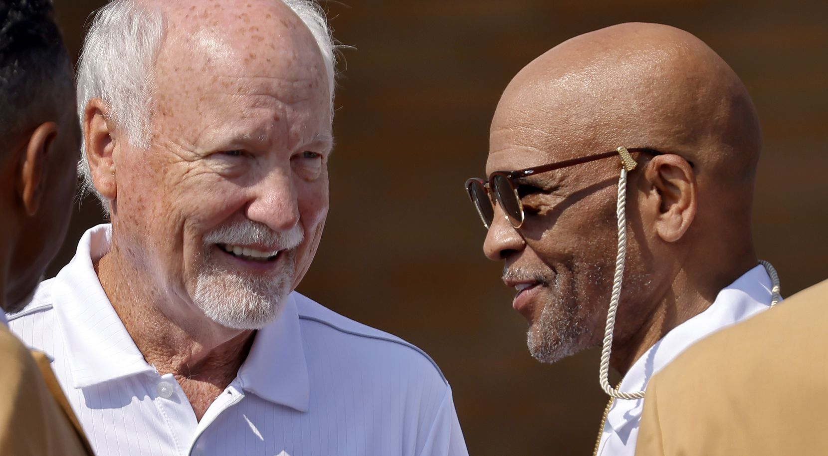 Dallas Cowboys Pro Football Hall of Fame inductees Cliff Harris (left) and Drew Pearson (right) visit before the Gold Jacket group photo outside the Hall in Canton, Ohio, Friday, August 6, 2021.