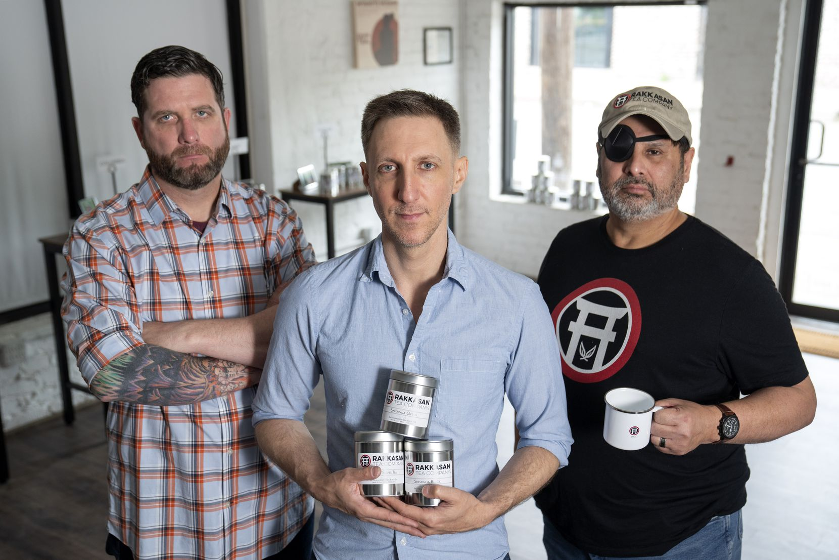 TK Kamauf, Brandon Friedman and Lance John, left to right, pose for portraits inside their new Rakkasan Tea brick-and-mortar store in Dallas.