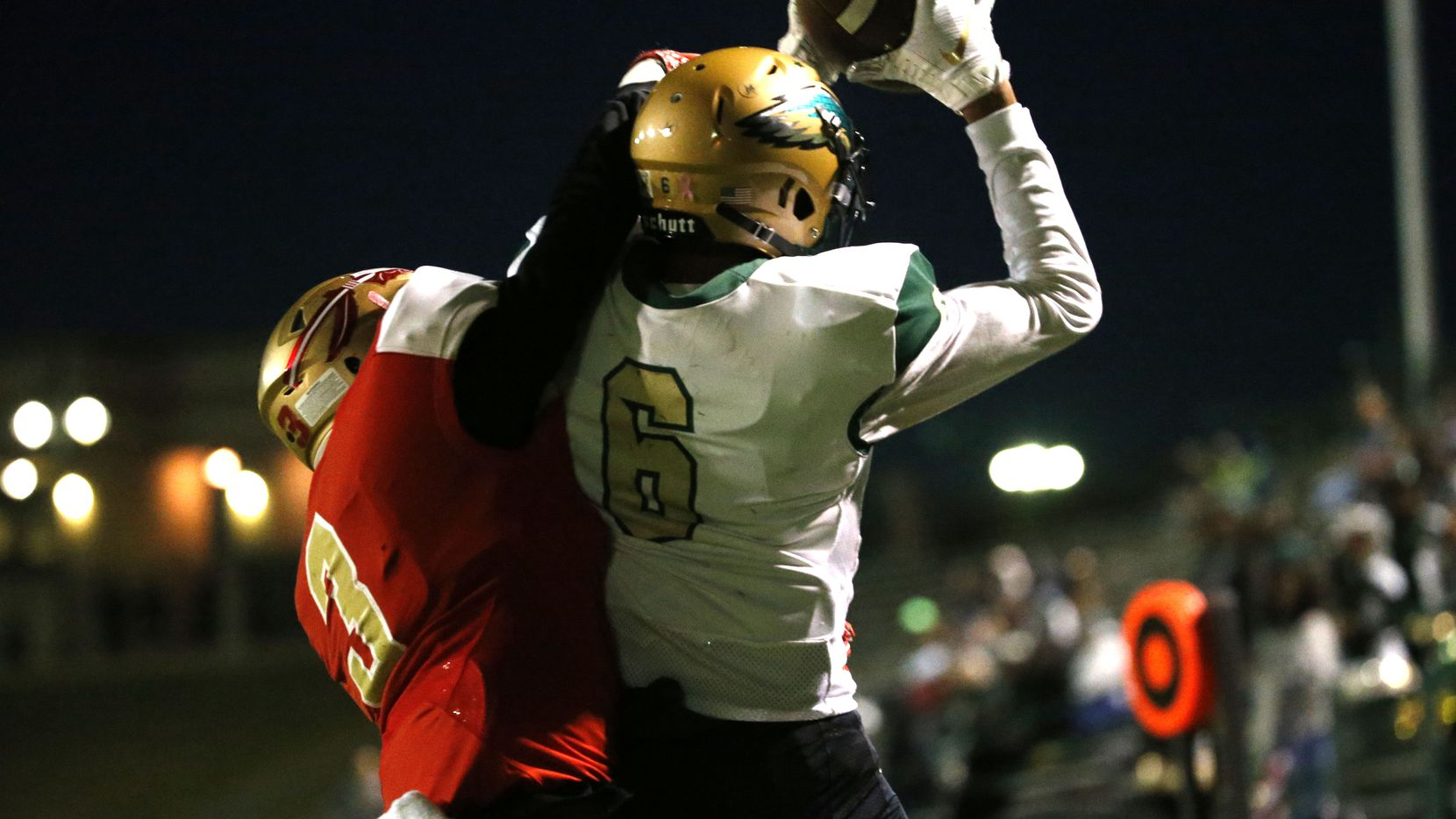 Desoto's Lawrence Arnold Jr. (6) catches a touchdown against South Grand Prairie's Earl Pugh (6) during the first half of their game at Gopher-Warrior Bowl in Grand Prairie on Nov. 1, 2018.