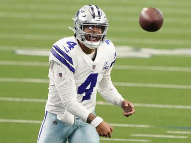 Cowboys quarterback Dak Prescott attempts a pass during the second quarter of a game against the Falcons on Sunday, Sept. 20, 2020, at AT&T Stadium in Arlington.