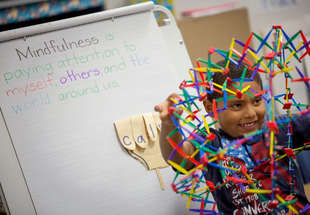 """Henry Zavala uses a """"breathing ball"""" as he and classmates take part in mindfulness exercises at Davis Elementary Monday, September 19, 2016 in Carrollton, Texas."""