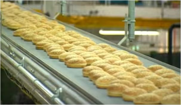 Buns roll through a Flowers Food bakery, as shown in this company promotional video.